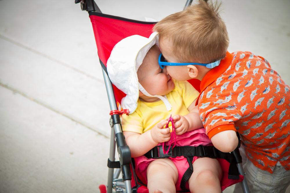 Big brother kissing his baby sibling