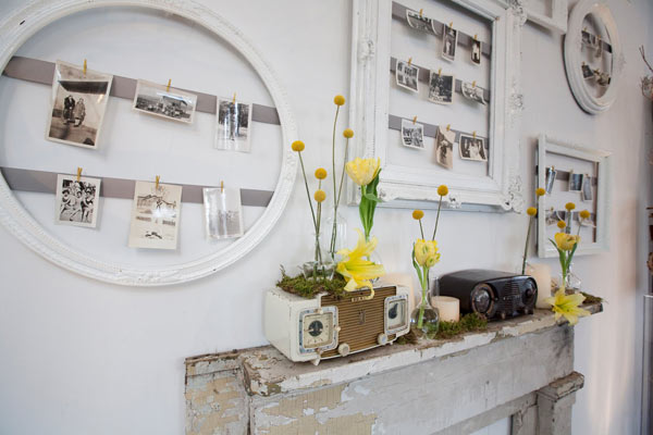 Small photographs hanging from wire in unique frames