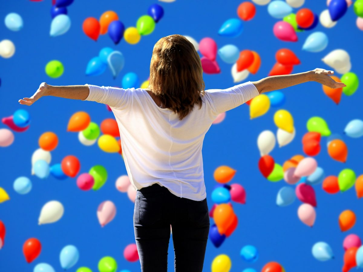 Woman standing in front of balloons